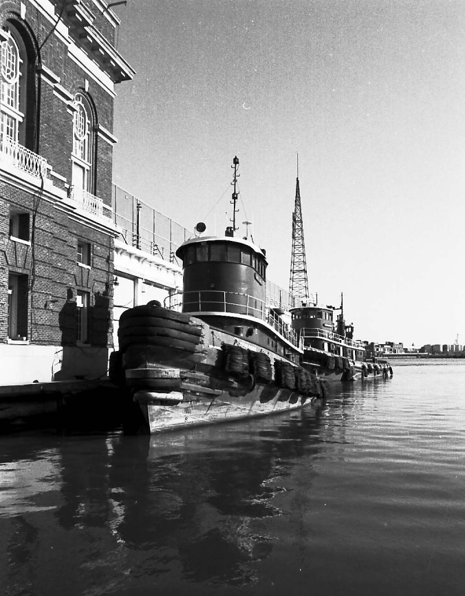 "When I worked in an office the bordered the Broadway Pier in Fells Point, I looked at my window at these tugboats every day. Sometimes you'd see scenes from ""Homicide: Life on the Streets"" shooting in front of the building on the left in the image as it served as the facade for the police station in the show."